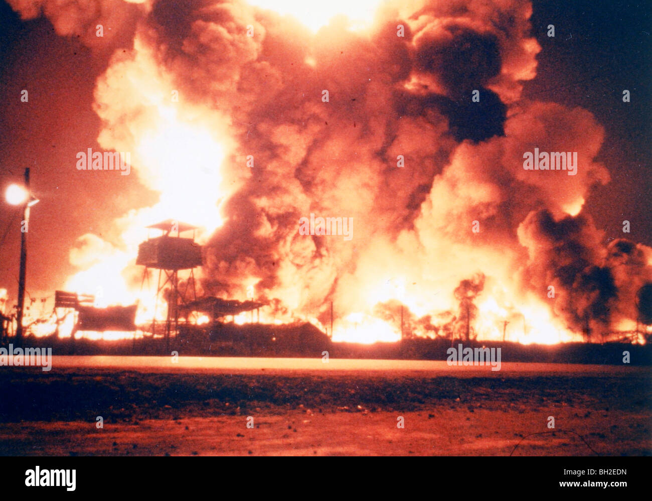 Qui Nhon, Vietnam: Fuel stores at the 321st ARVN POL depot burn after being ignited by Viet Cong 82mm mortar fire - Stock Image
