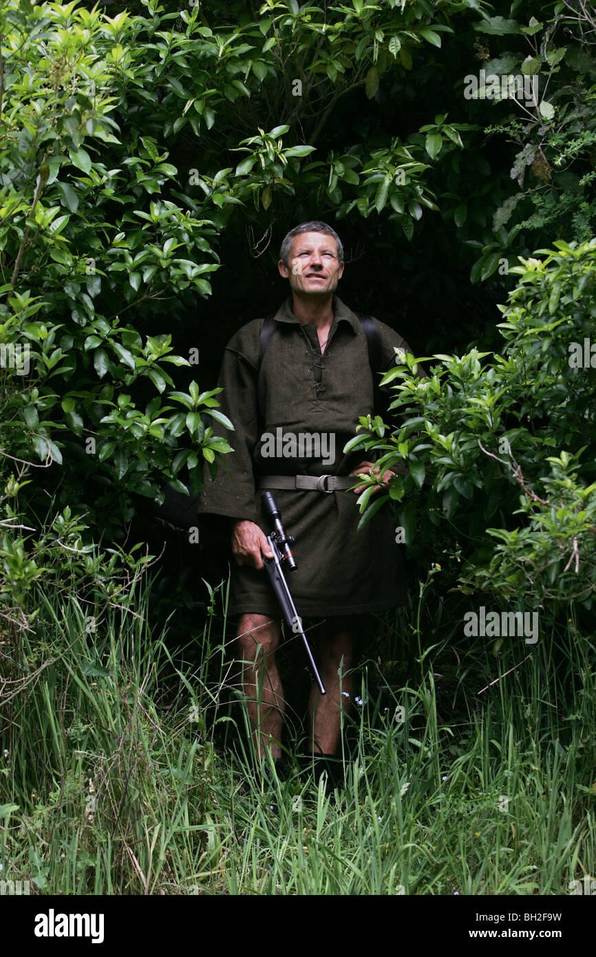 Hunter Keith Marshall in native bush at The Brook Waimarama Sanctuary, Nelson, New Zealand - Stock Image