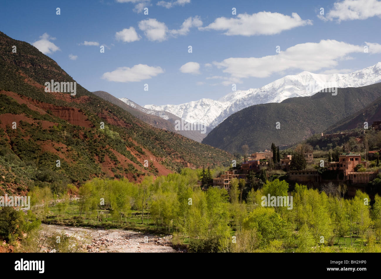 Looking down the Ourika Valley to the snow covered Atlas Mountains - Stock Image