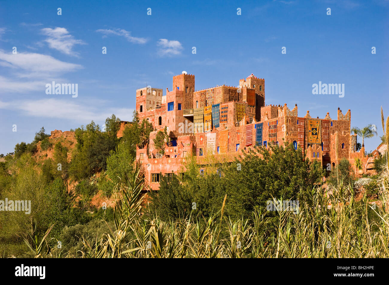 Carpets hanging outside a kasbah in the Ourika Vally, Morocco - Stock Image