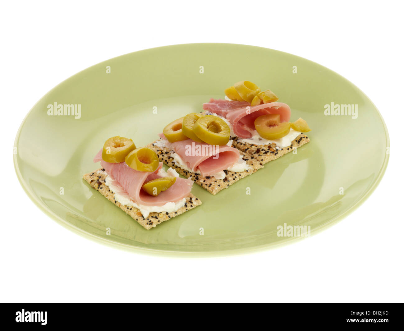 Multigrain Crackers with Ham and Olives Stock Photo
