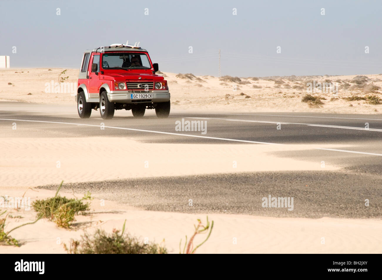 desert road roads sand sandy road slippery surface surfaces driver driving in on dust dusty wind swept blown across - Stock Image