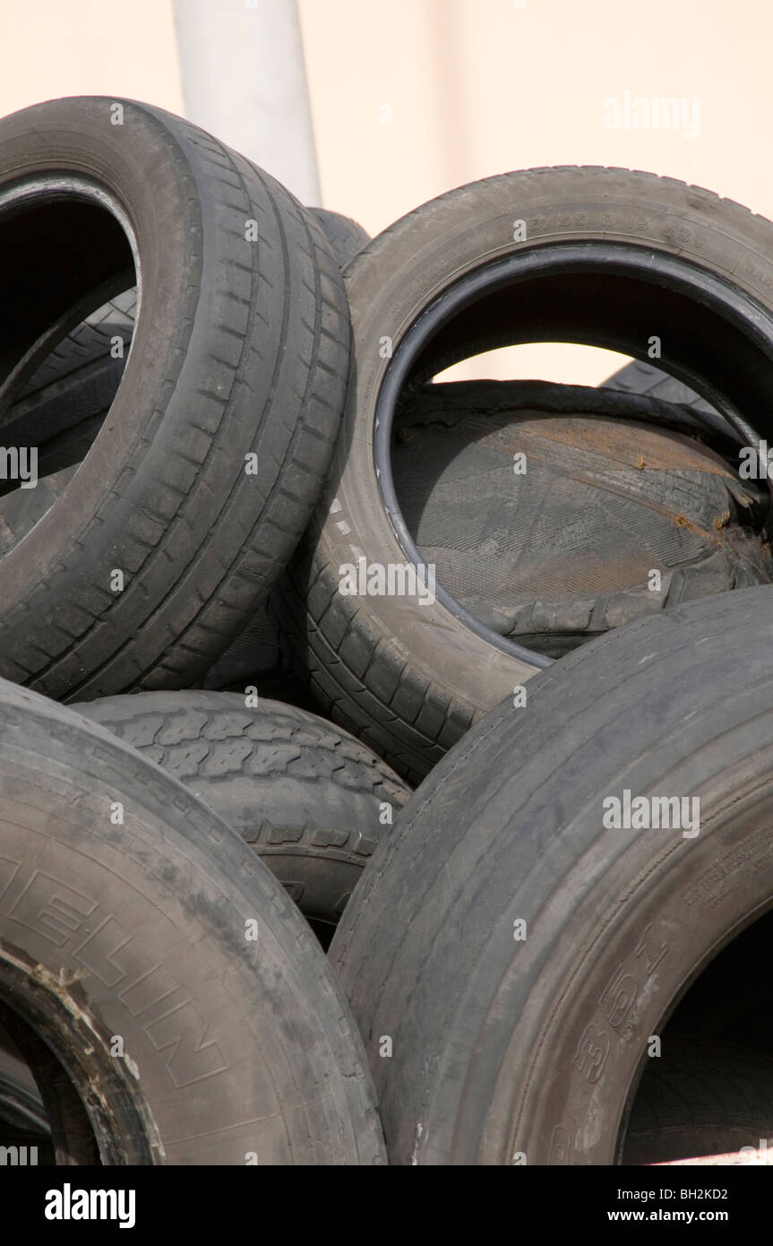 old car tires tyres tire tyre cars rubbish tread worn out down rubber disposal trash waste environmental charge - Stock Image