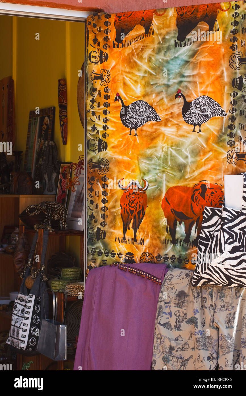 Clothing and curios on sale at a curio shop in Howick on the Midlands Meander, Kwazulu Natal, South Africa. Stock Photo