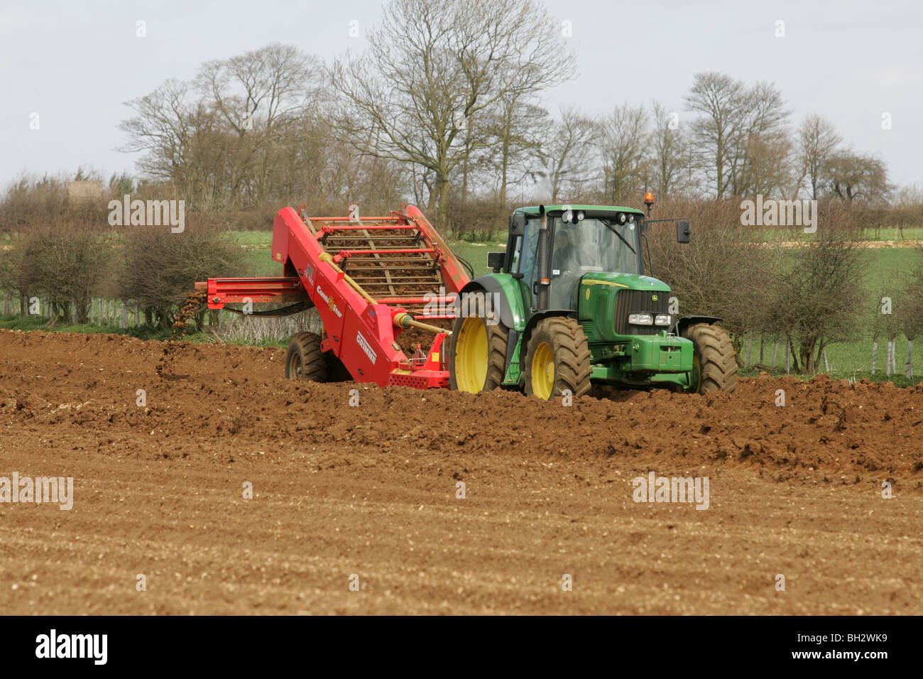Tractors stone separating ready for planting potatoes - Stock Image