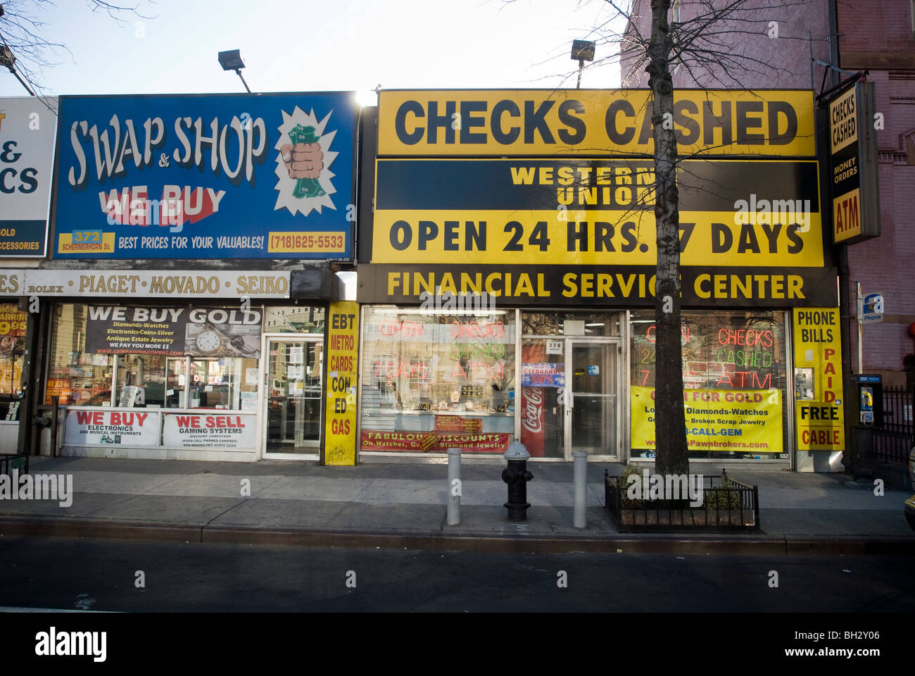 A check cashing business and a second hand store along Flatbush