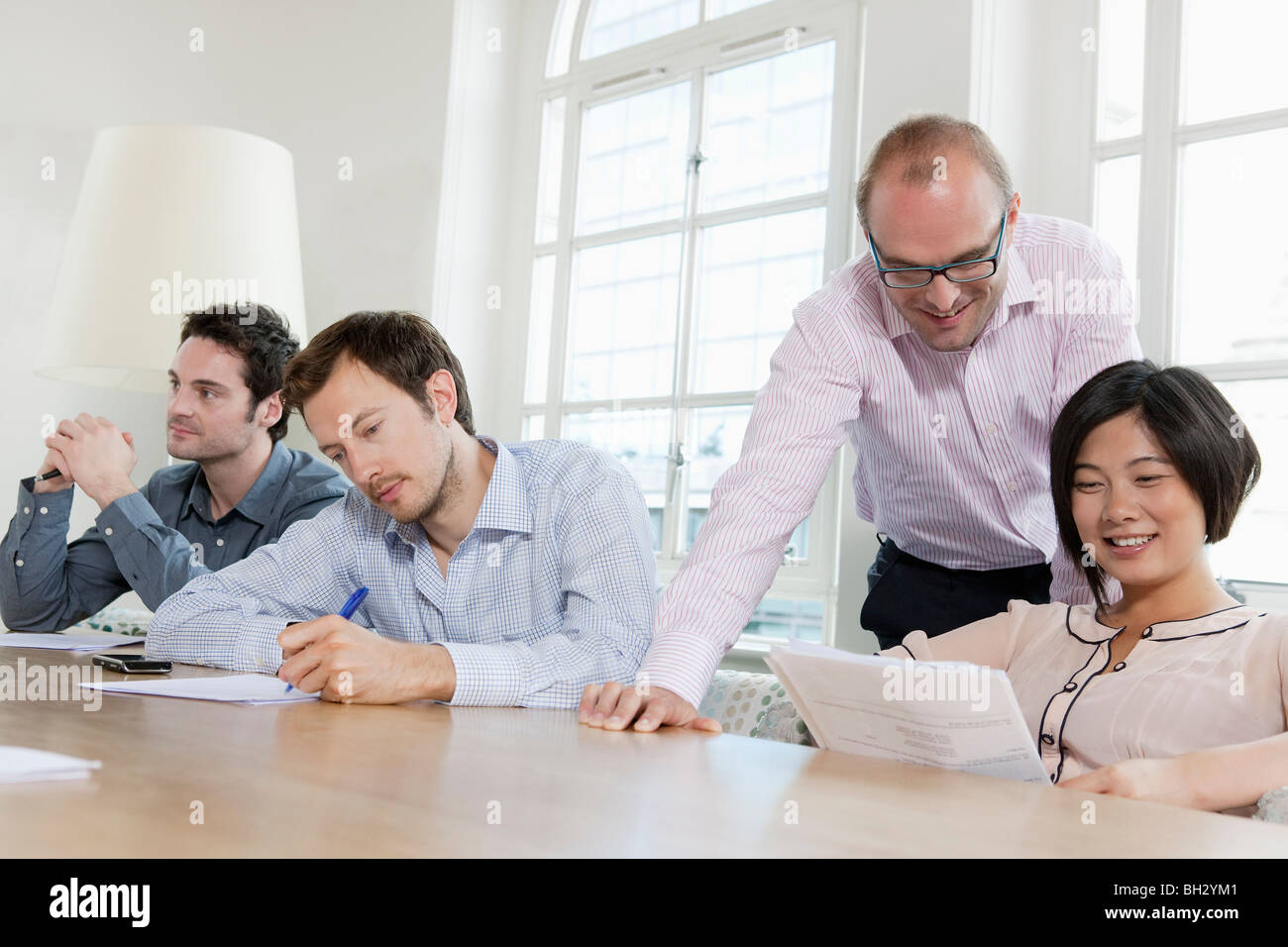 Group of people at a conference table Stock Photo