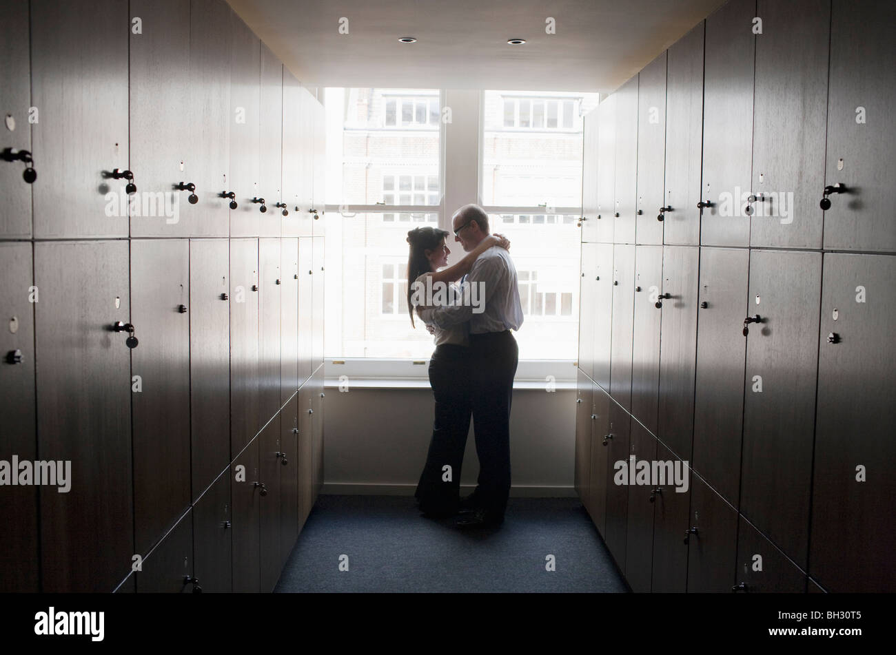 Couple office workers in locker room - Stock Image