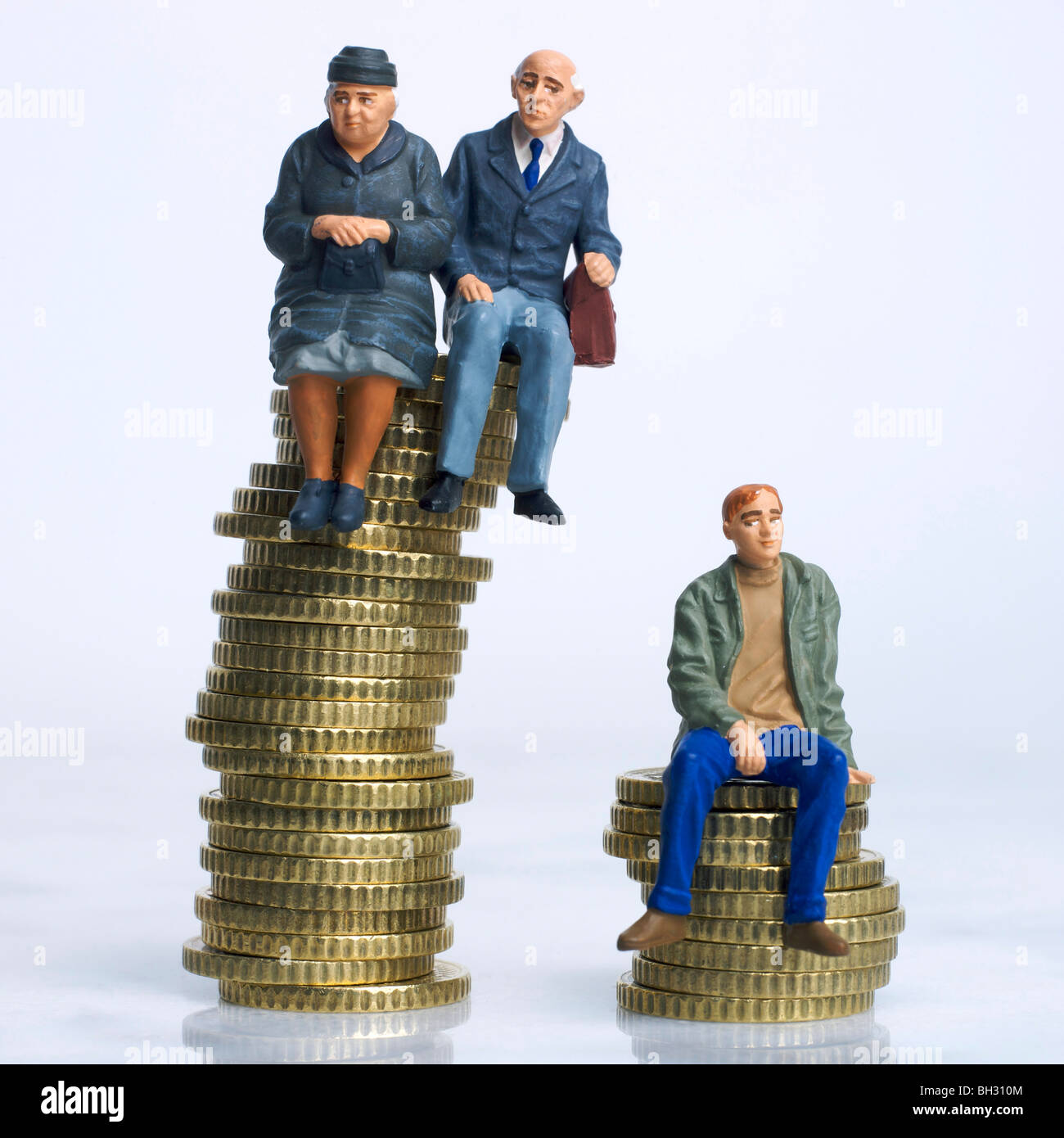 Old and young figures sitting on coins - inheritance / disparity in savings / pension money / old v young income - Stock Image