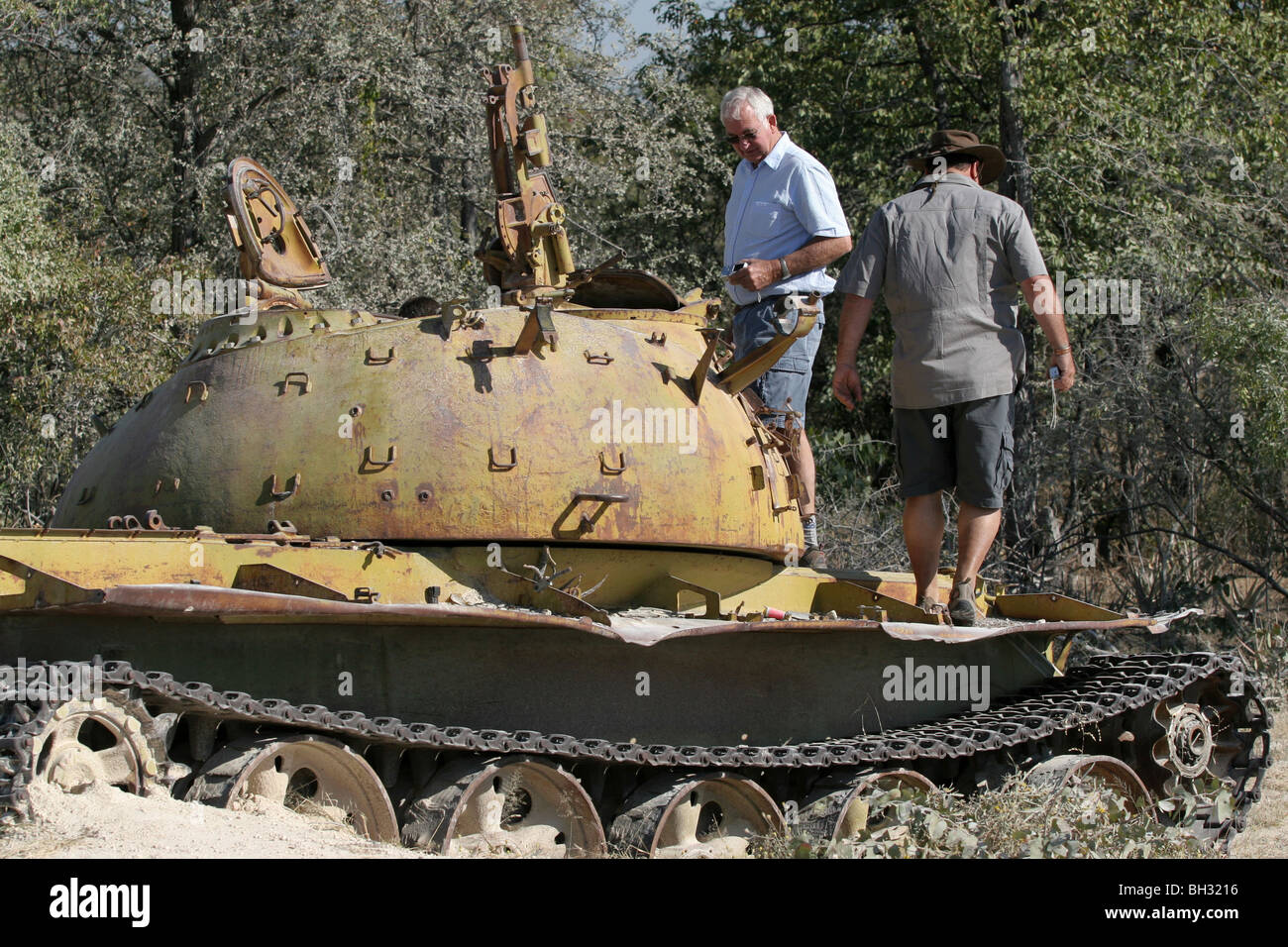 Abandoned military tank on the road between Ondjiva and Cuvelai in Angola, remnants from the war between FAPLA and - Stock Image