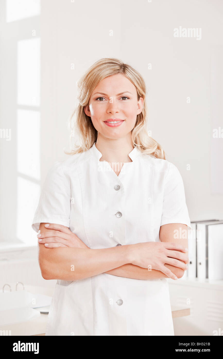Woman in a white lab coat - Stock Image