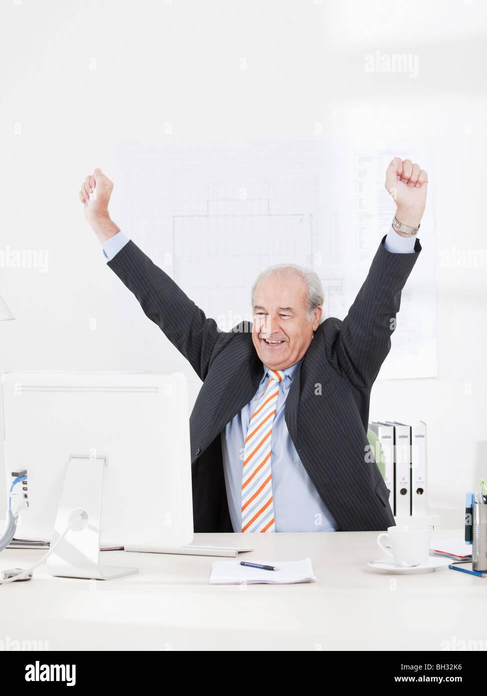 Senior businessman jubilating Stock Photo