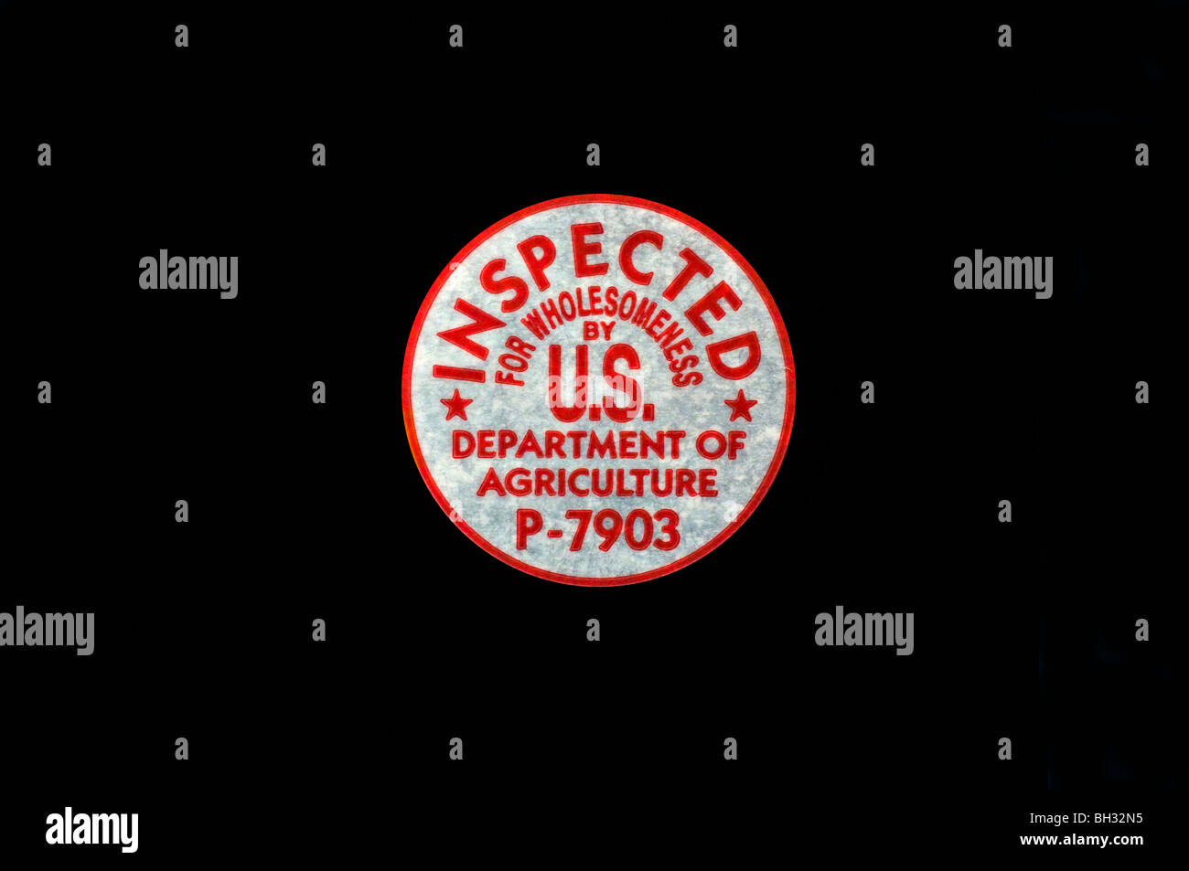 Cut Out. U.S. Dept. of Agriculture Wholesomeness Stamp (P-7903) on black background. - Stock Image