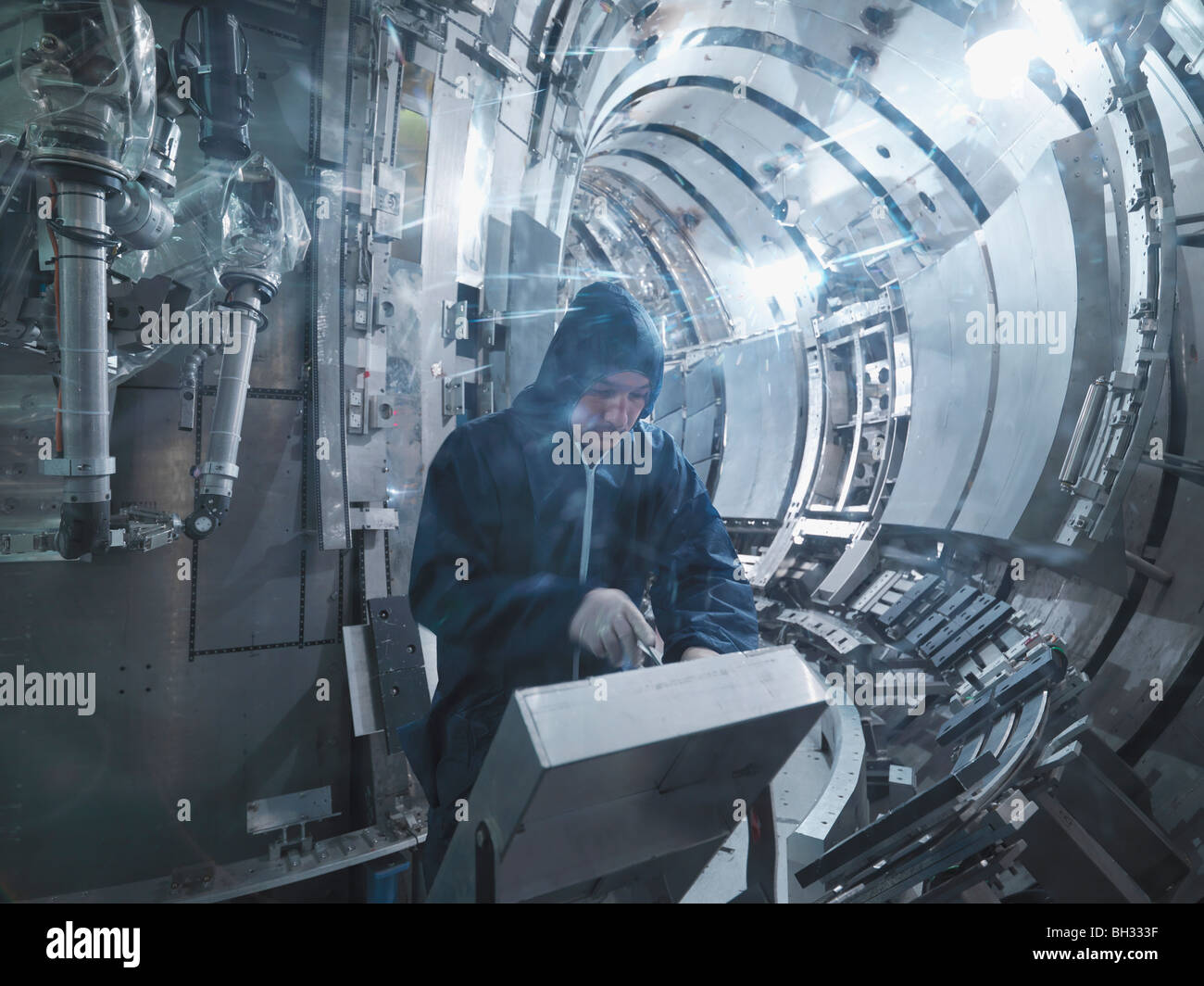 Scientist Working In A Fusion Reactor - Stock Image