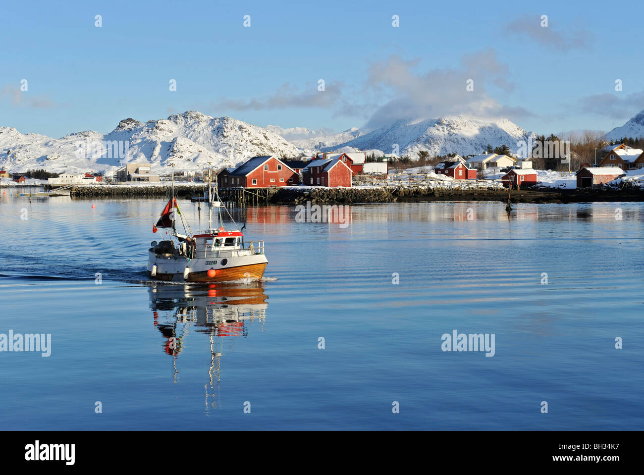 Small fishing boat, a smack, on the calm sea in Lofoten islands, North Norway - Stock Image
