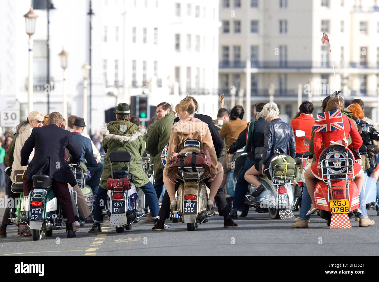 Film extras dressed as Mods on the set of Brighton Rock in Eastbourne. Picture by James Boardman - Stock Image