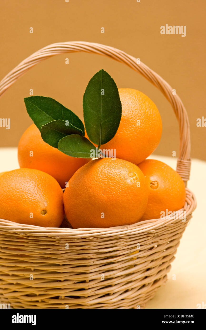 Close-up of basket with oranges - Stock Image