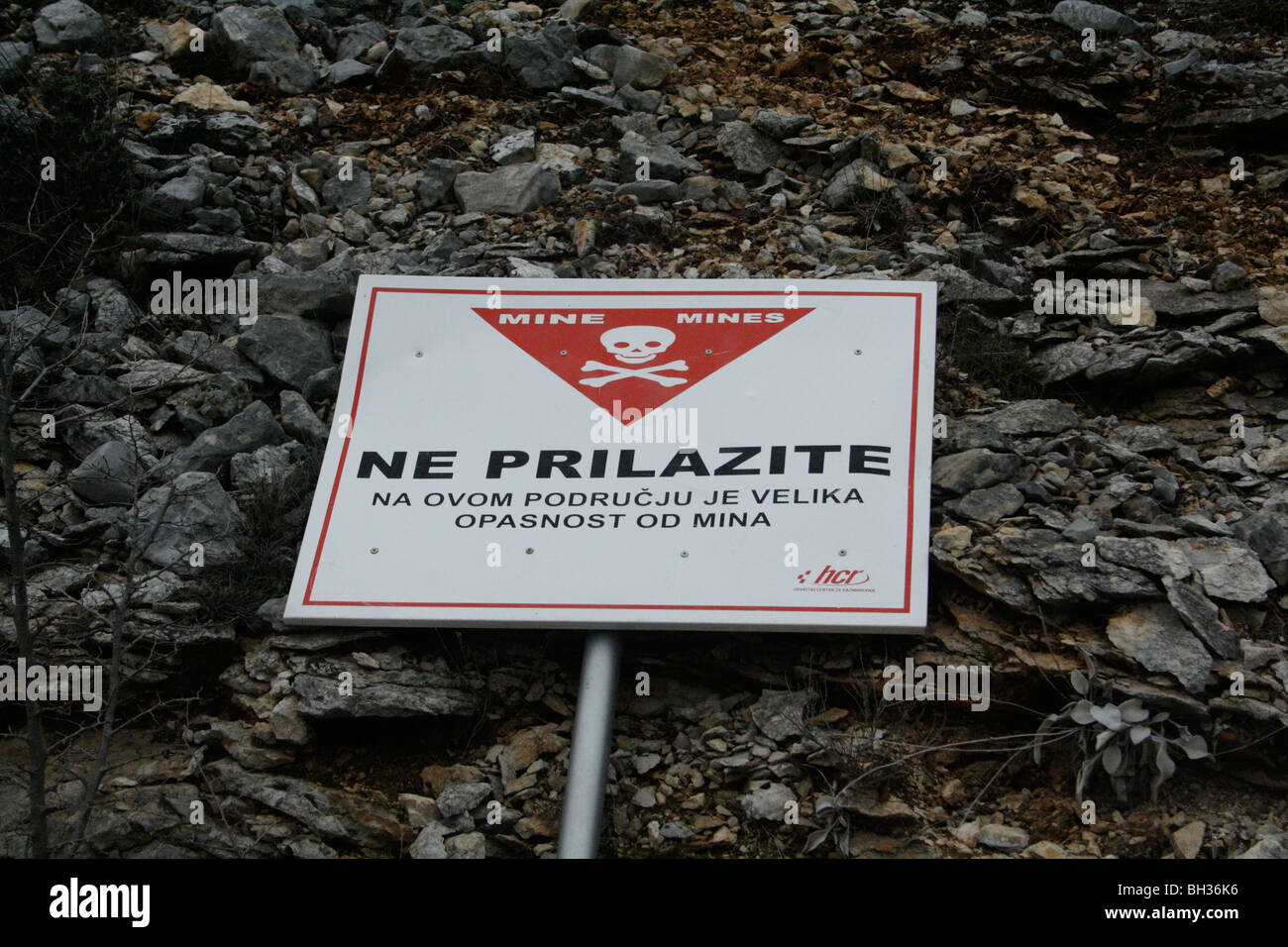 Sign 'Warning Land Mines' in Croatian language found in the former war zone on the Croatian-Bosnian border - Stock Image