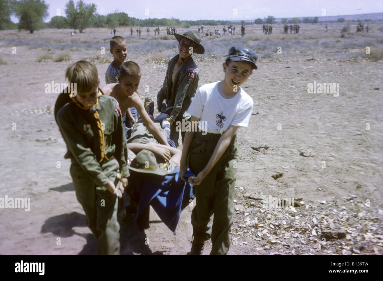 Boy scouts of Troop 123 learn first aid skills during a 1965 camporee at Sandia Reservation in New Mexico. first - Stock Image