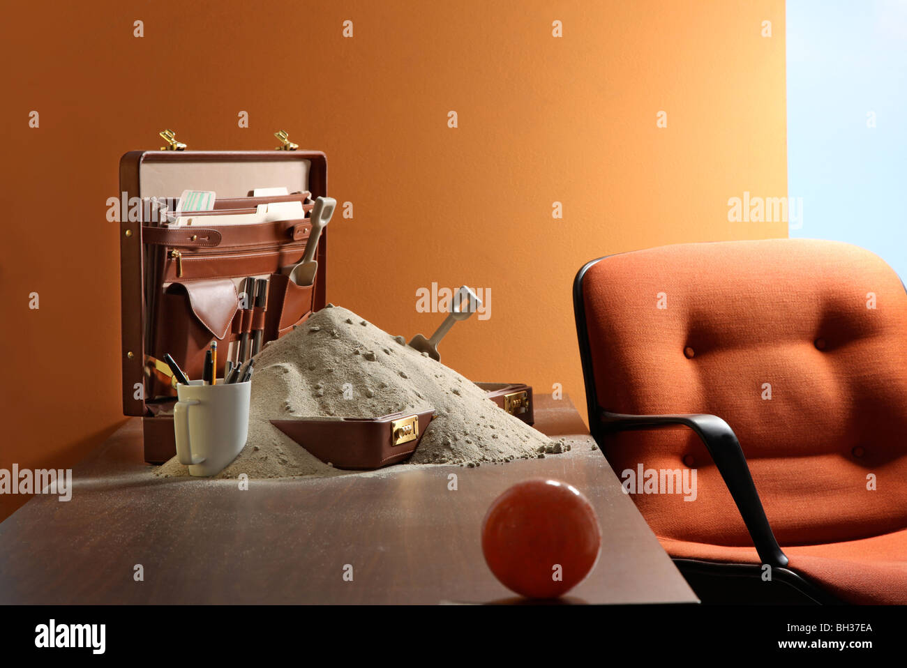 Pile of beach sand on work desk - Stock Image