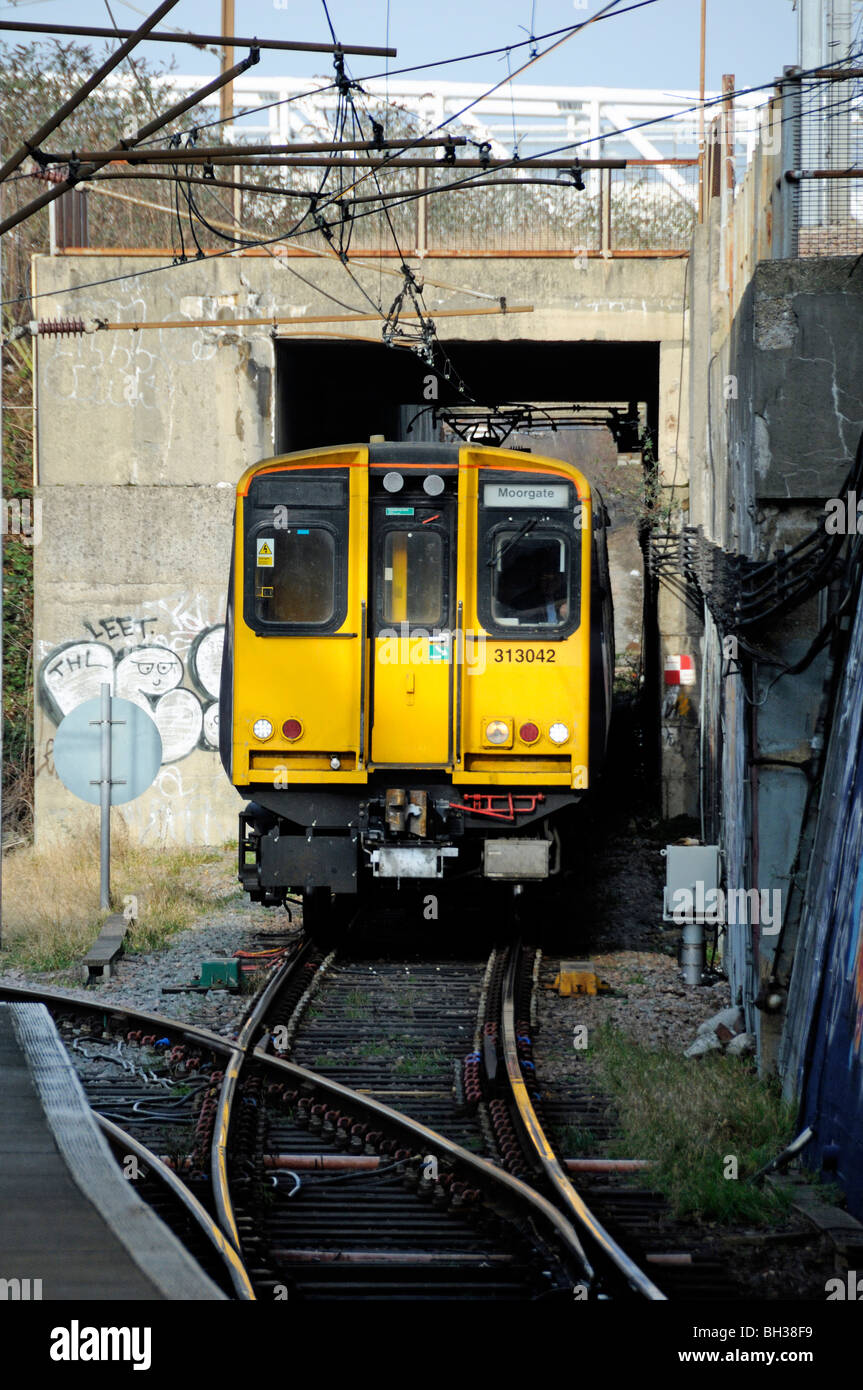 Moorgate train coming out of the tunnel into Drayton Park Station Highbury Islington London England UK - Stock Image