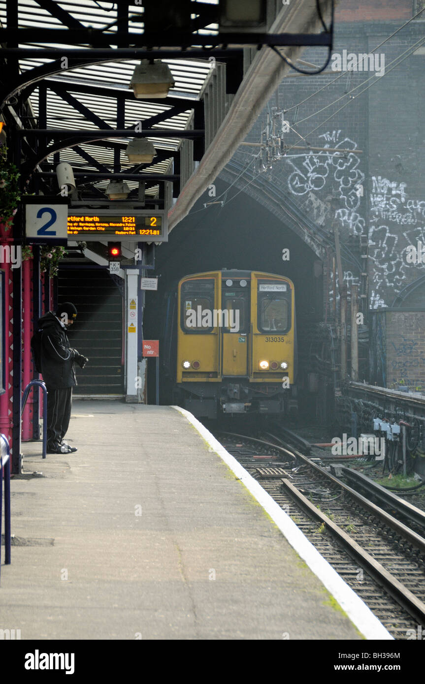 Platform Drayton Park Station with train arriving Highbury Islington London England UK - Stock Image