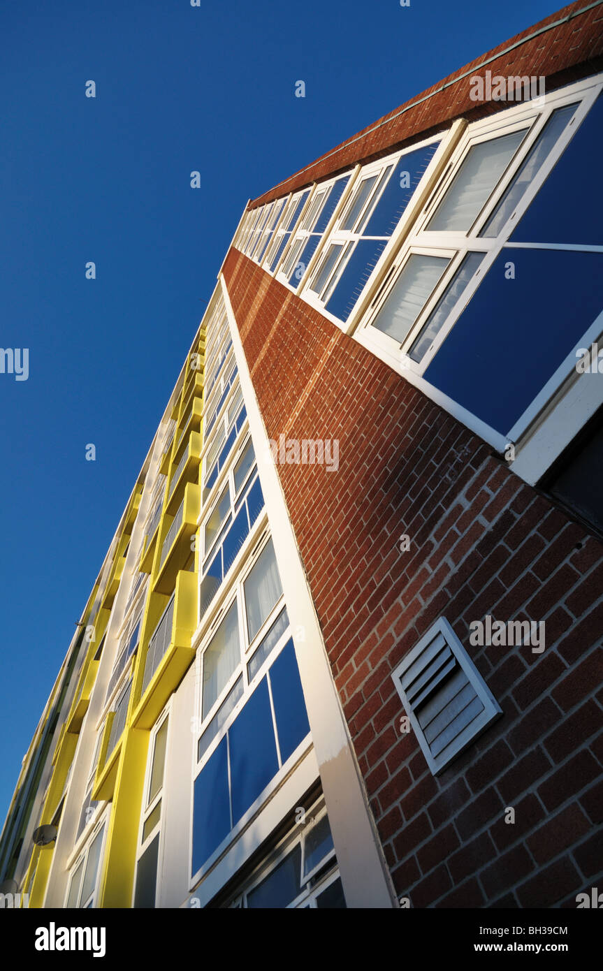 a British city Council estate block of flats on a cold sunny day looking upward towards the sky. - Stock Image