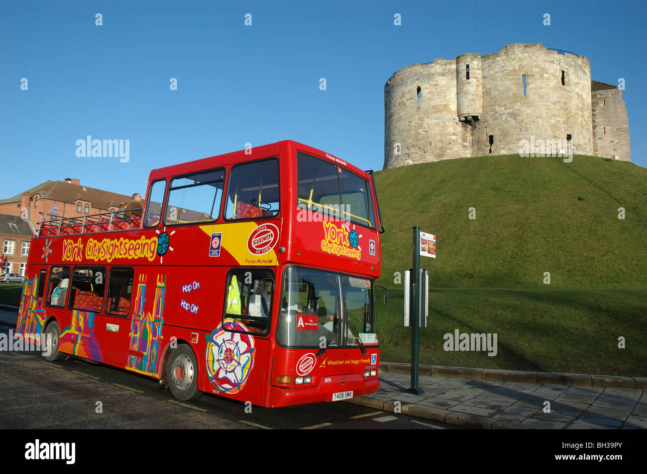 open top sightseeing bus parked at Cliffords Tower, York, England, UK - Stock Image