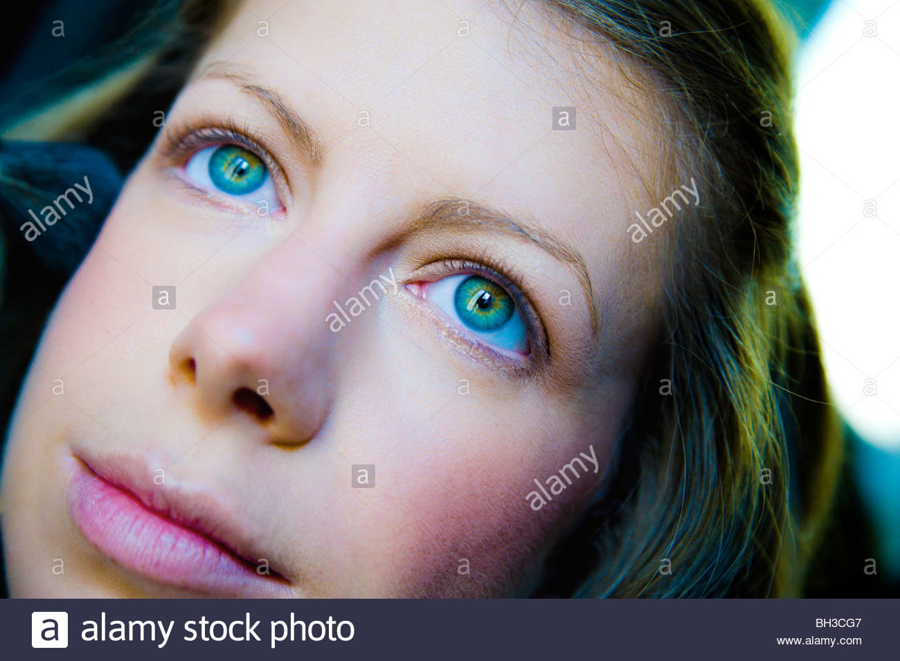 Close-up of young woman's face - Stock Image