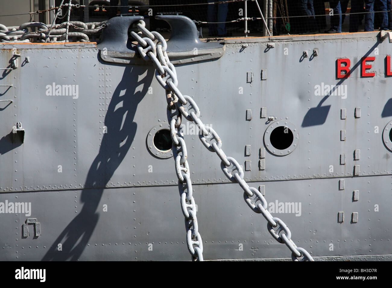 HMS Belfast, anchor chain and portholes. Moored on River Thames between London and Tower bridge's. Battleship - Stock Image