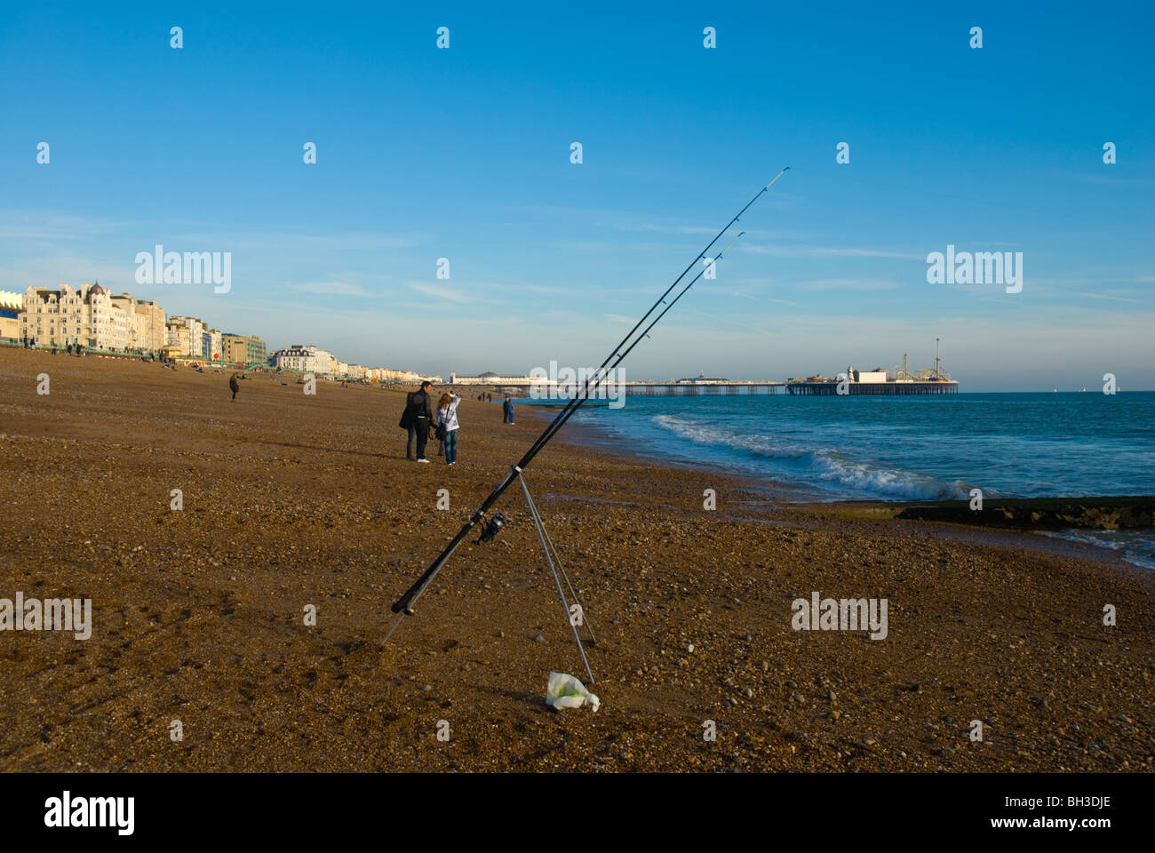 Fishing rod standing on its own at beach in Brighton England UK Europe - Stock Image