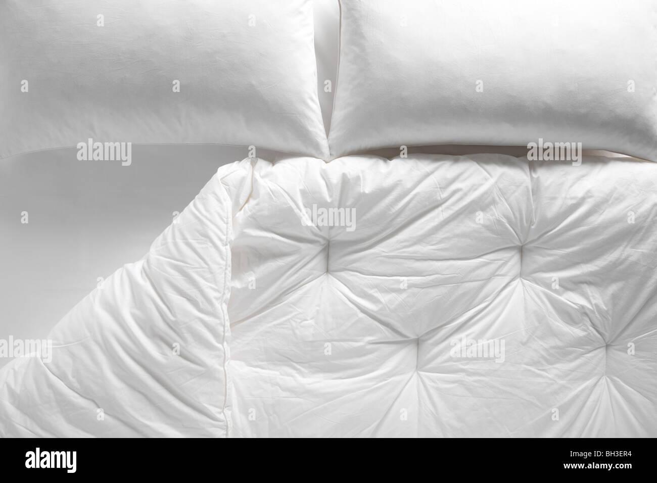 White duvet and pillows - Stock Image