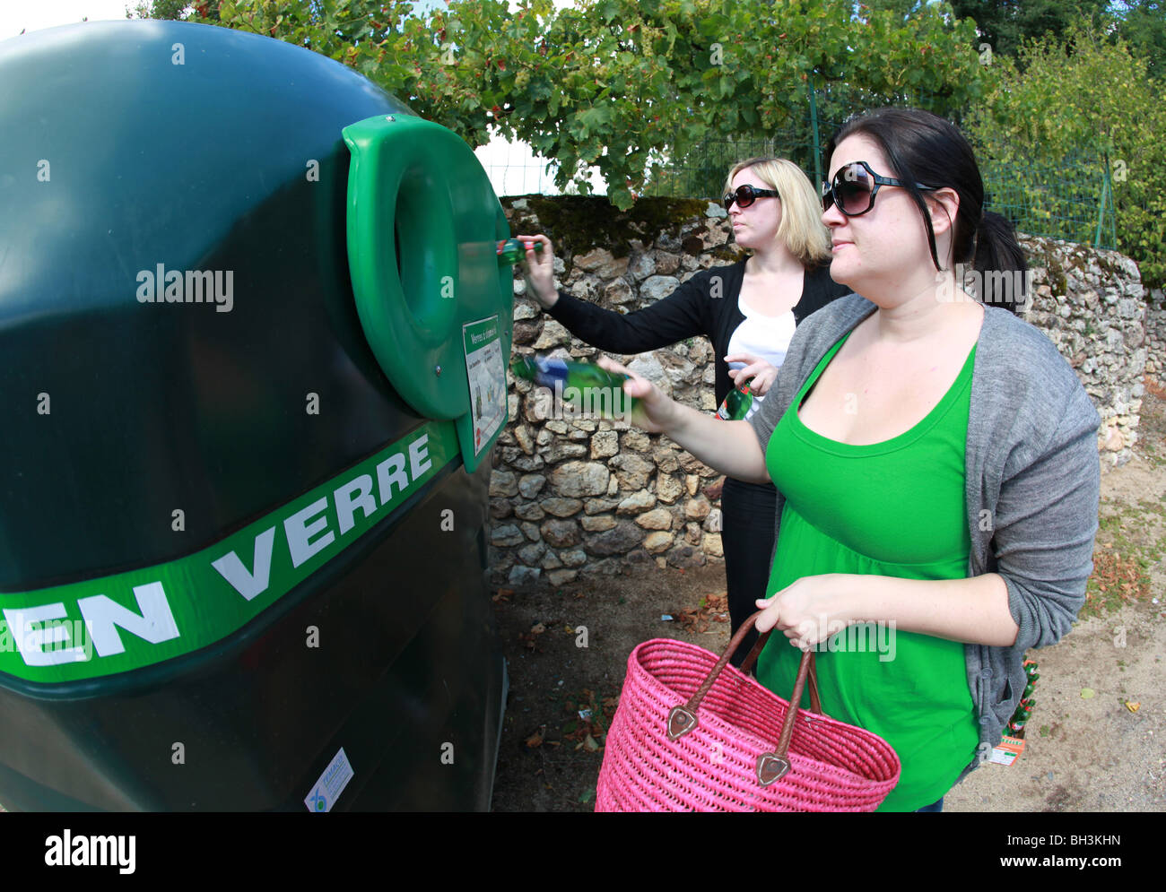 People recycling glass bottles, France. Stock Photo