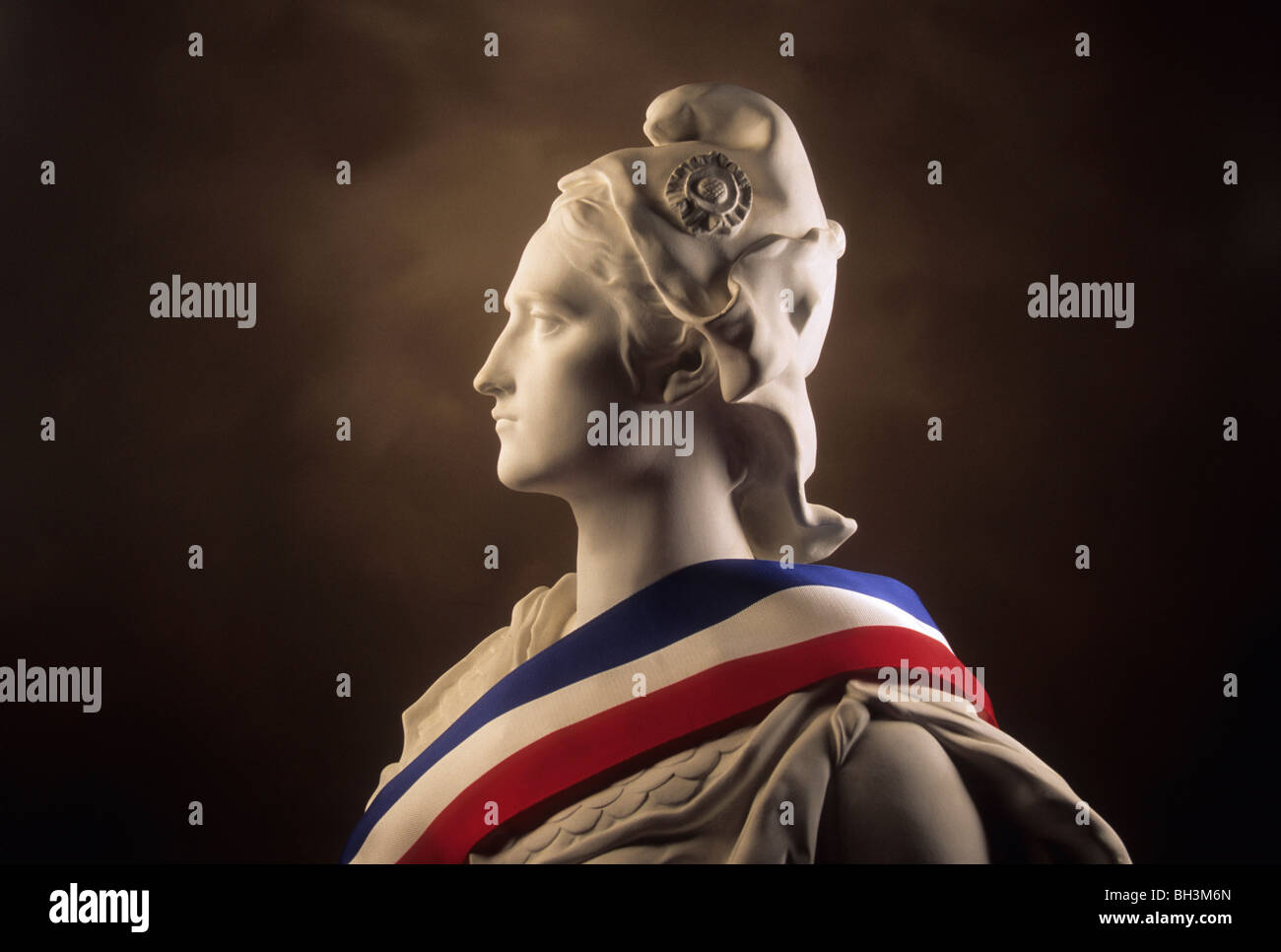 Statue of Marianne, national symbol of the French Republic draped in the French flag - Stock Image