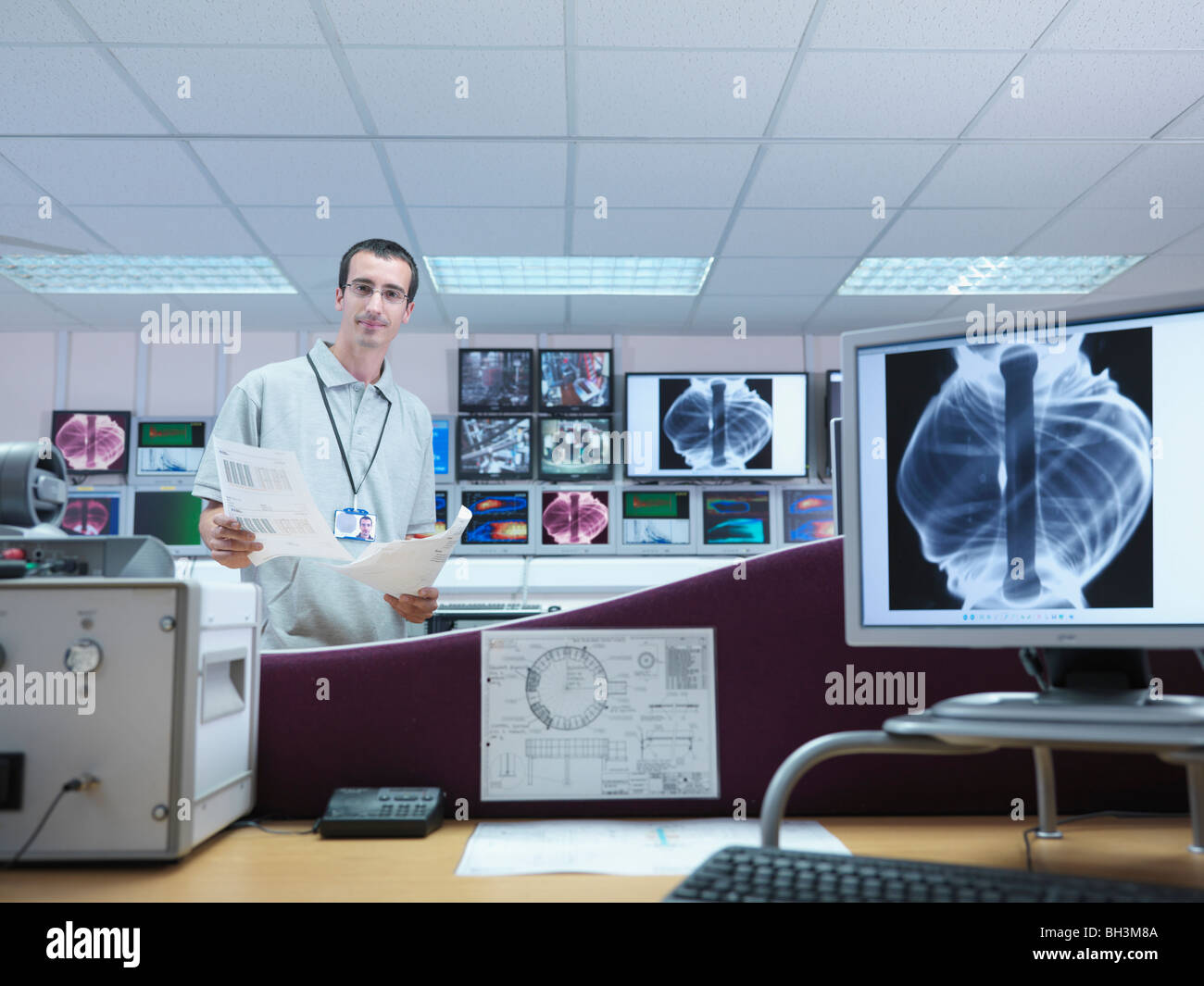 Fusion Reactor Scientist With Screens - Stock Image