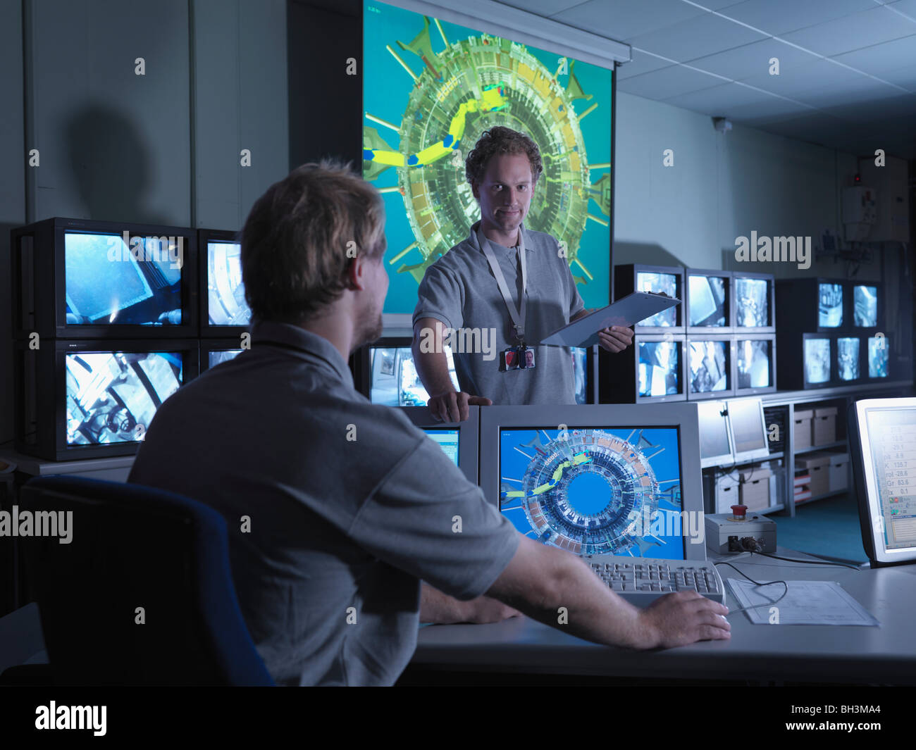 Fusion Reactor Scientists At Work - Stock Image