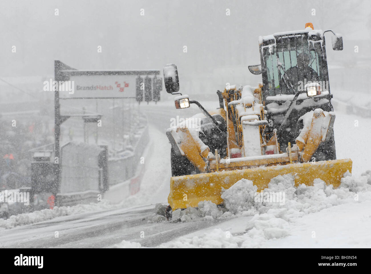 A snow plough clears the track at Brands Hatch before the first round of the new British Superbike season, 6th April - Stock Image