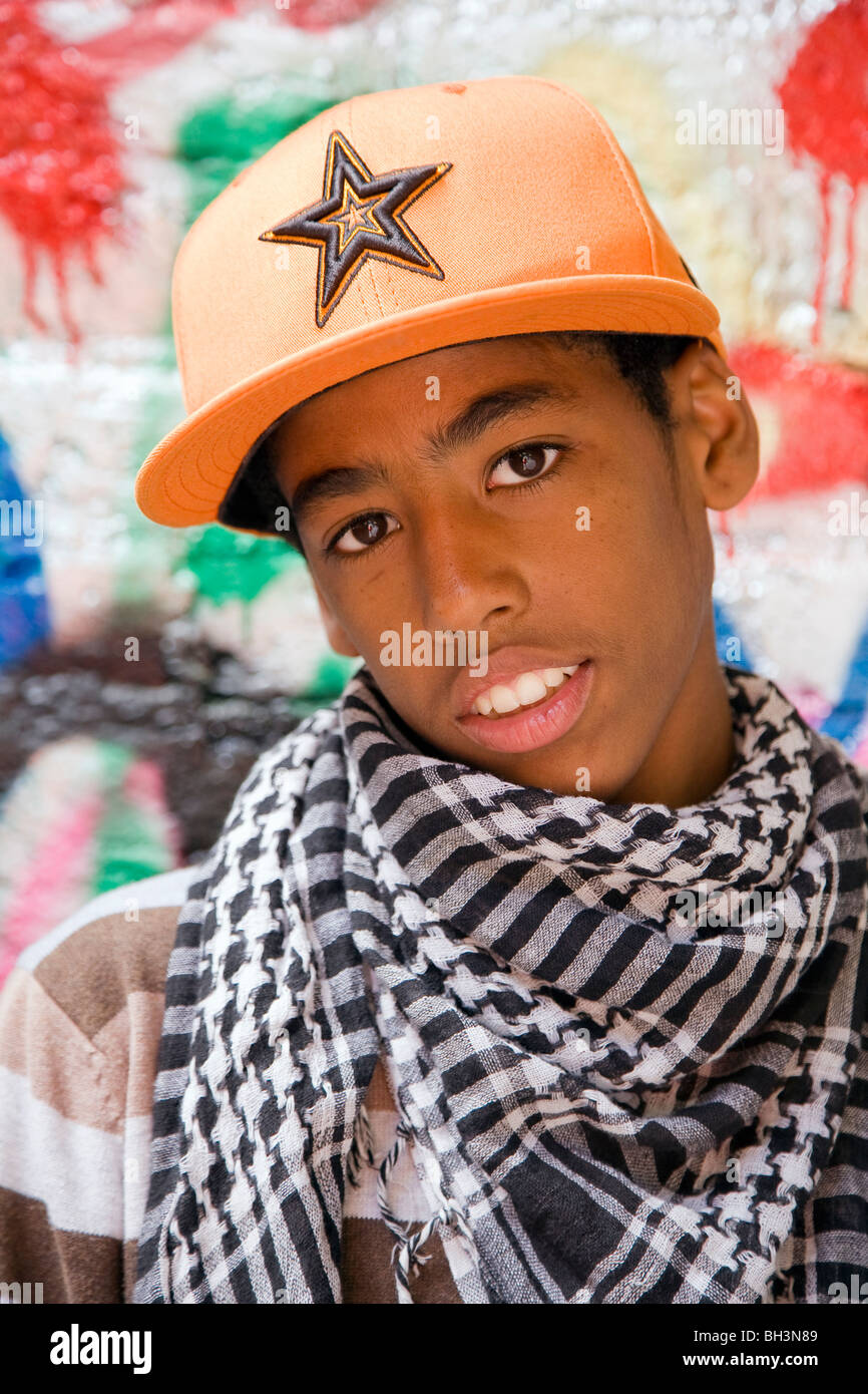 Black Teenager against graffiti wall - Stock Image