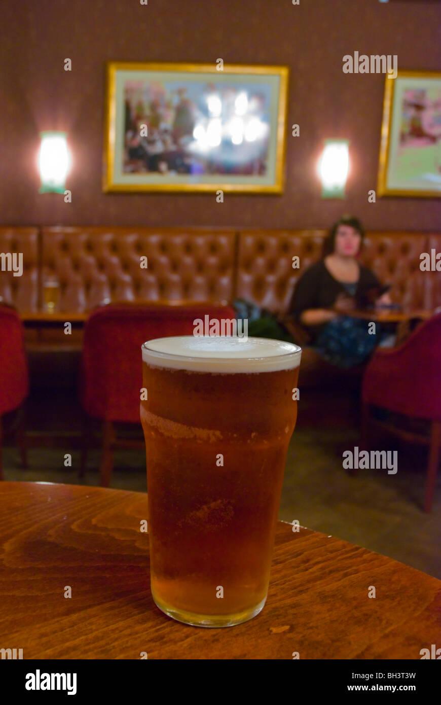 Pint of bitter ale Earl of Lonsdale pub along Portobello Road London England UK Europe - Stock Image