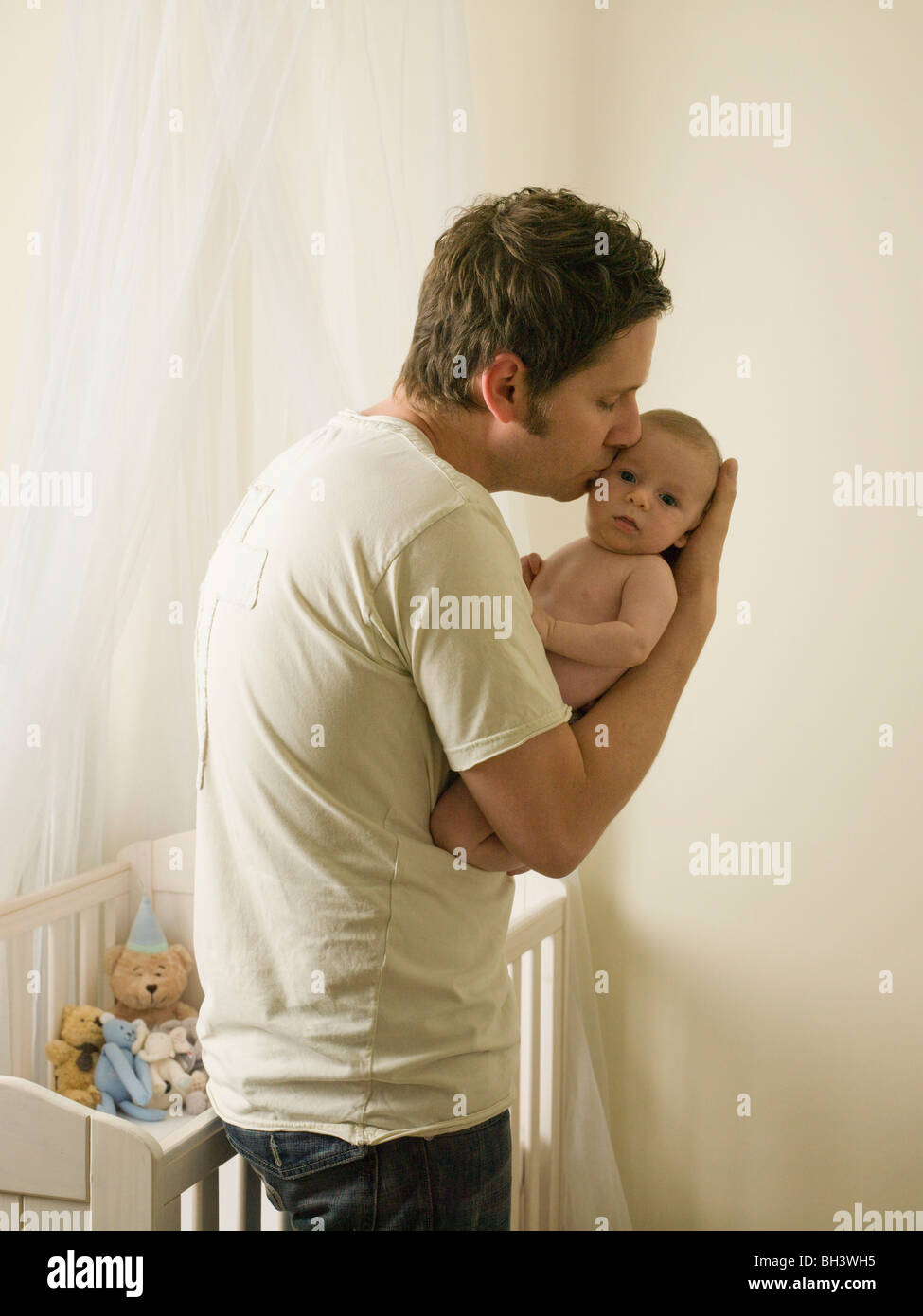 A father holding his new born baby - Stock Image