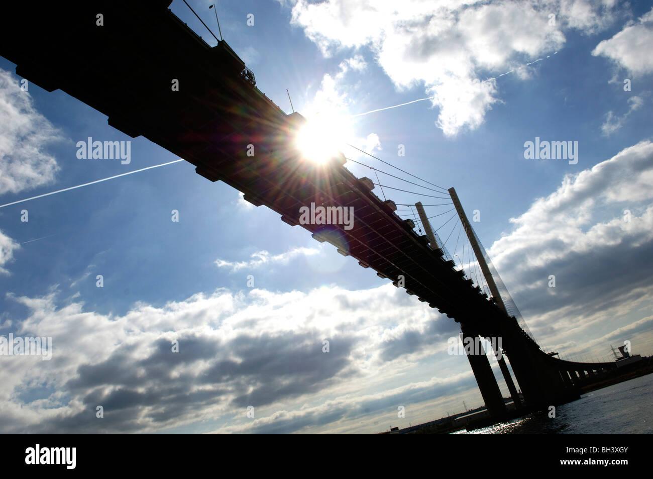 The sun bursts through under the Dartford Bridge, Kent, 1st October 2009. - Stock Image