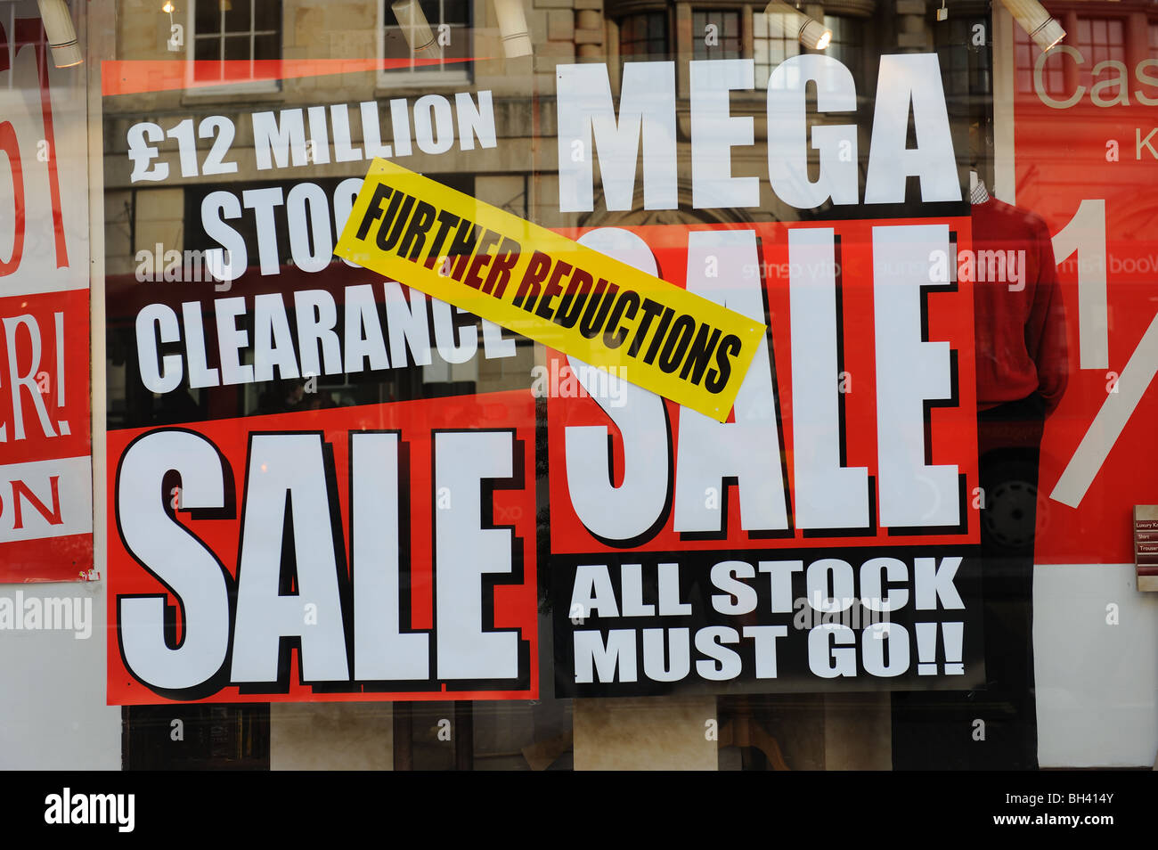 sale poster in a shop window Sale clearance cut-price recession Christmas New Year bargain January sales - Stock Image
