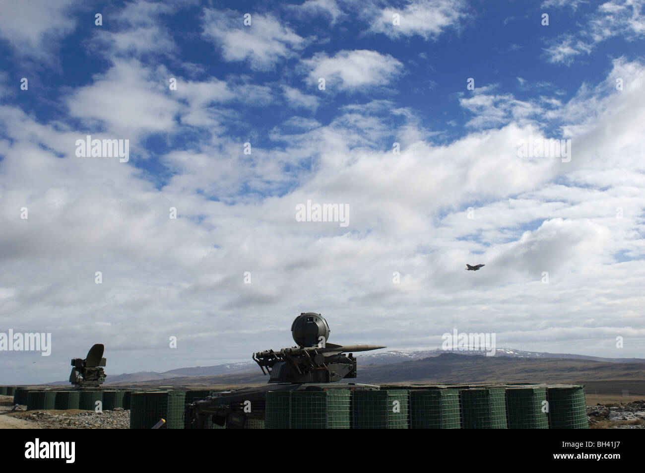 A Tornado F3 flies past a Rapier missile battery on the Falkland Islands - Stock Image