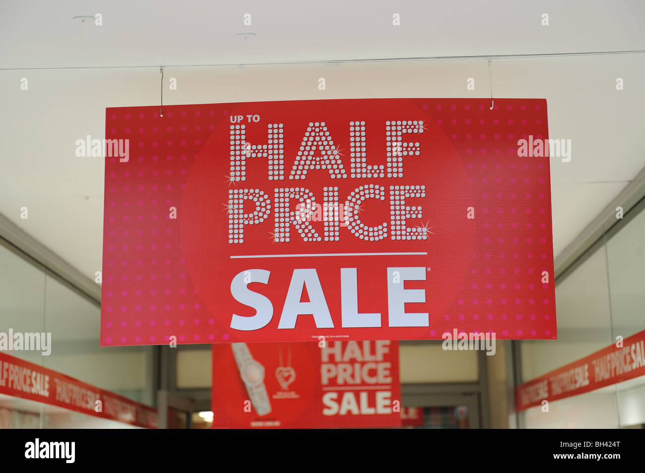 sign sale sales clearance cut-price recession Christmas New Year bargain spend save credit  money reduced stock - Stock Image