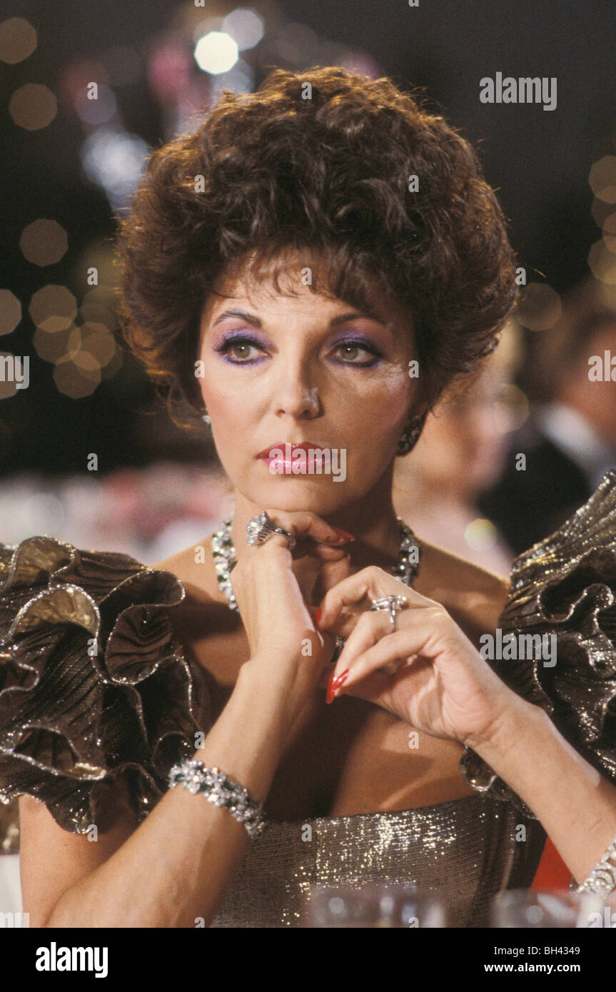 Actress Joan Collins as Alexis Carrington on the set of the television soap opera 'Dynasty' in the 1980s - Stock Image