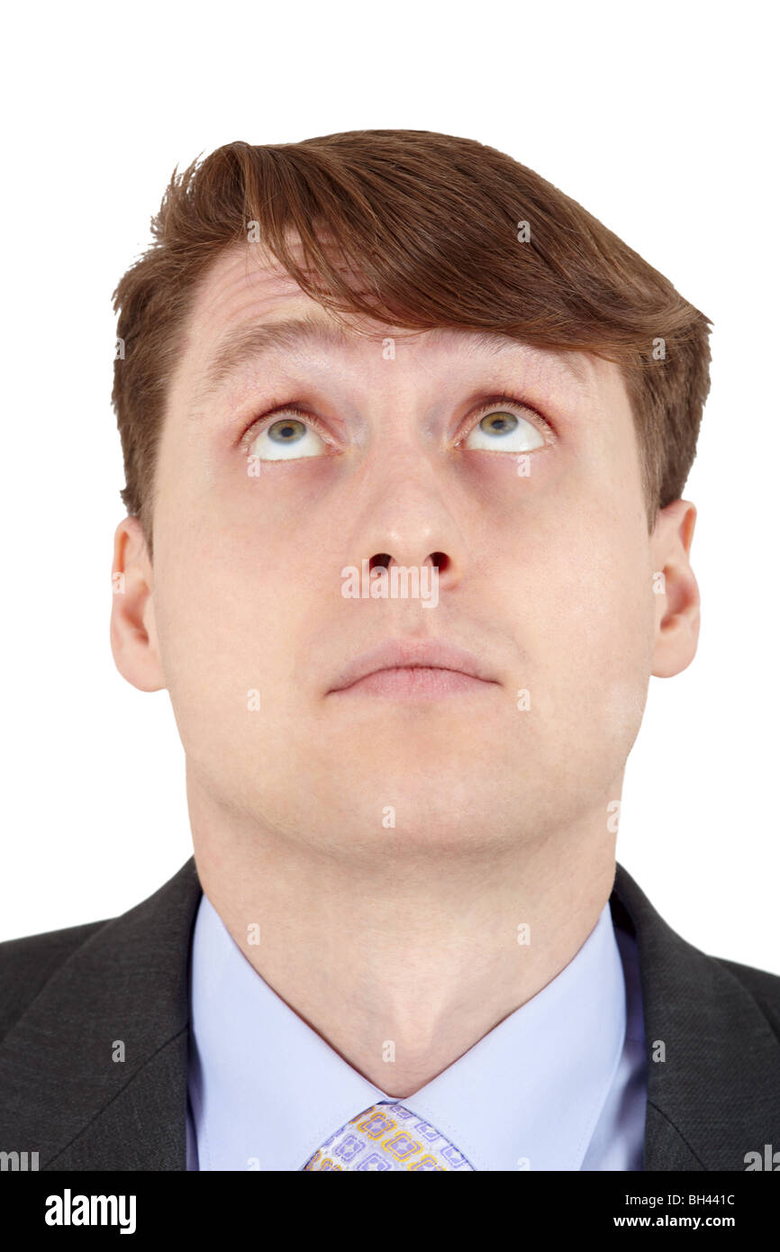 Young man looks up, isolated on a white background - Stock Image