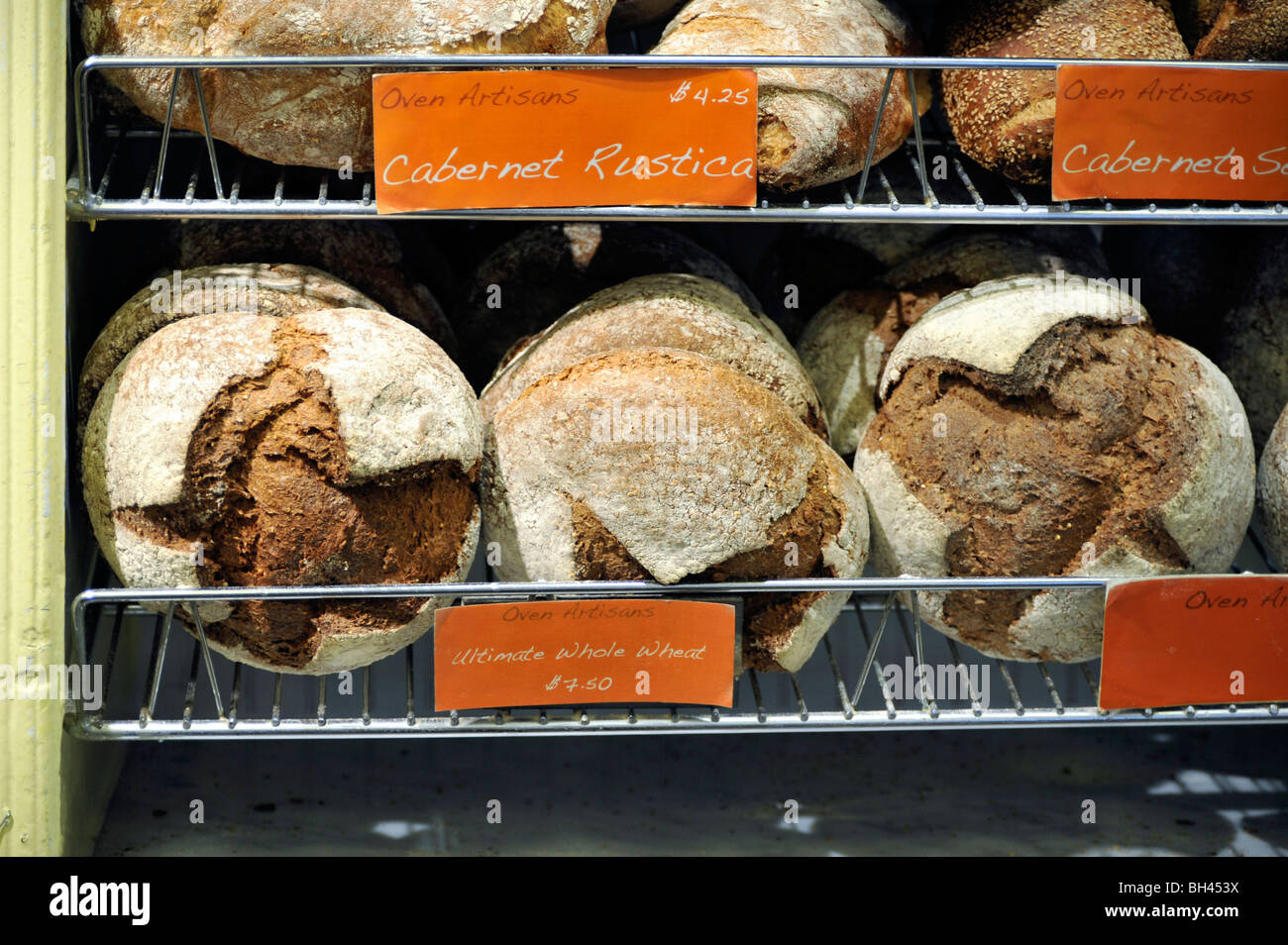 Fresh Artisan Bread displayed in a Bakery - Stock Image