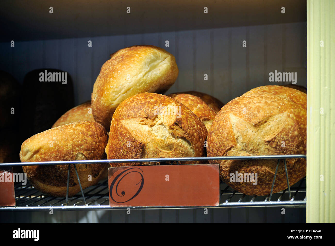 Fresh Sour Dough Artisan Bread Displayed in a Bakery - Stock Image