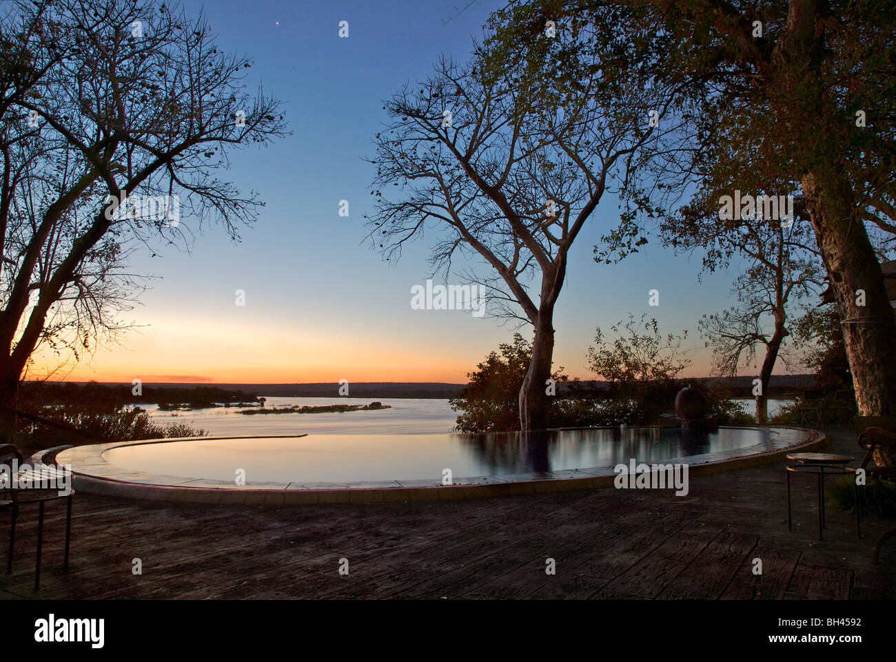 Plunge pool overlooking Lake Victoria at the River Club at sunset. - Stock Image