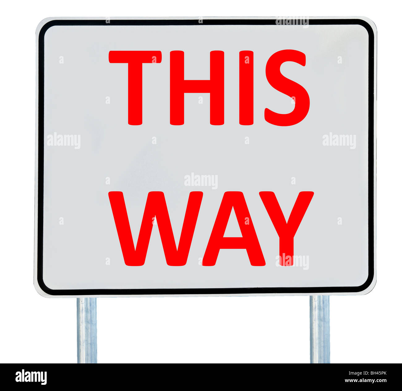 A 'This Way' road sign isolated on white. - Stock Image
